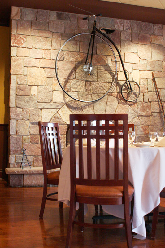 Arrowhead Golf Club Restaurant, with antique bicycle hanging on the wall