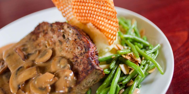 Turkey Meatloaf dish with mushroom sauce and green beans